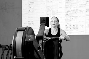 woman on rowing machine - workout