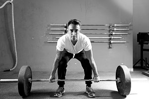 young man on a weightlifting session