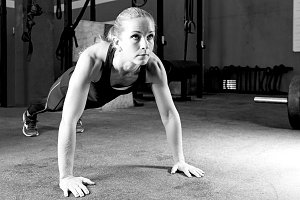 young woman making pushups - workout