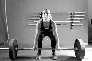 young woman on a weightlifting sessi