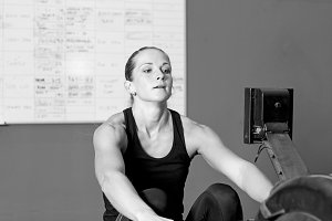 young woman on rowing machine