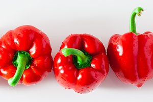 banner of group of red ripe organic bell pepper  isolated on whi