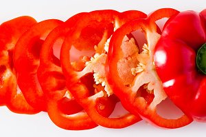 banner of sliced red bell pepper isolated on white