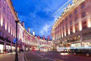 2016 June 16 Popular tourist Regent street with flags union jack in night lights