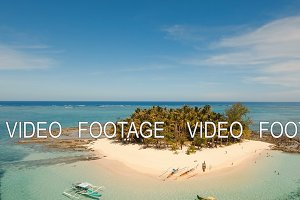 Aerial view beautiful beach on tropical island. Guyam island, Philippines, Siargao.