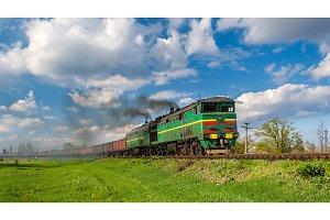 Heavy freight train hauled by diesel locomotive.