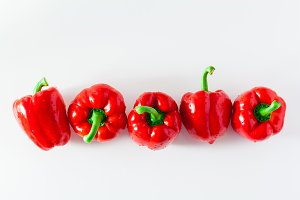 group of red ripe organic bell pepper  isolated on white. copy s
