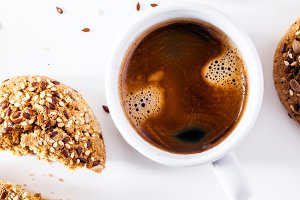 a cup of espresso and fresh biscuits on a white background. a fr