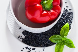 Fresh red bell pepper, basil leaves and black lentils in a set o
