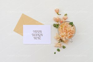 Postcard mockup, flowers & envelope