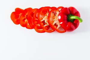 sliced red bell pepper isolated on white