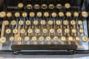 Ancient vintage portable typewriter with qwerty keyboard