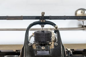 Ancient vintage portable typewriter with ball type typeface head