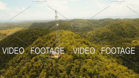 Telephone Signal Tower Among Green Forest And Mountains Aerial View Siargao Island Philippines