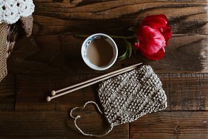 Knitting project with coffee