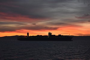 Merchant ship at dawn