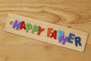 Happy fathers day  on wooden background