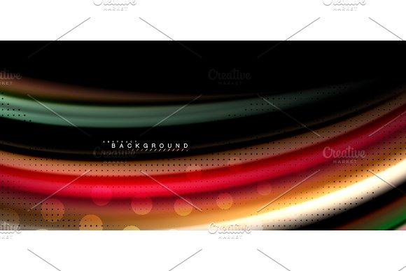 Multicolored wave lines on black background design in Illustrations