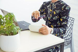 Office worker with black laptop