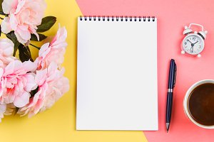 Empty notebook with blue pen on yellow-pink pastel background. mock-up, frame, template.