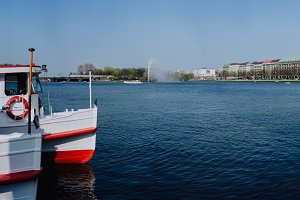 Cruise tourist boat on the Pier on Alster Lake, Hamburg, Germany