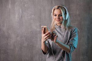 Charming young woman using smartphon