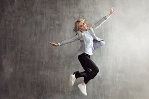 jumping woman in business suit