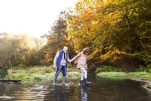 Senior couple on a walk in autumn nature.