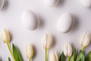 Flowers and white eggs on a white background.