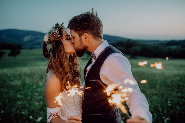 People Stock Photos: HalfPoint - Beautiful bride and groom with sparklers on a meadow.