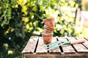 Garden tool and flower pots in the garden.