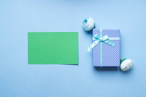 Green greeting card and gift box