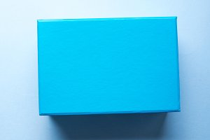 Blue box on pastel abstract background
