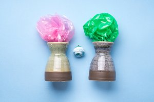 Vases with plastic conceptual flowers