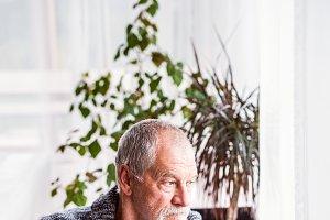 Senior man relaxing at home.