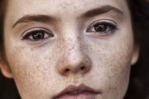 face of the girl with freckles