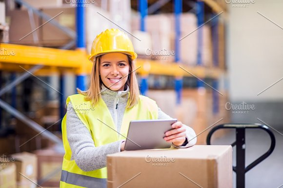 Woman Warehouse Worker With Tablet