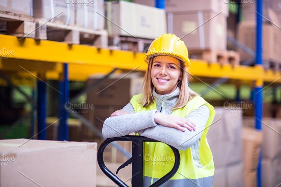 Portrait Of A Young Woman Warehouse Worker