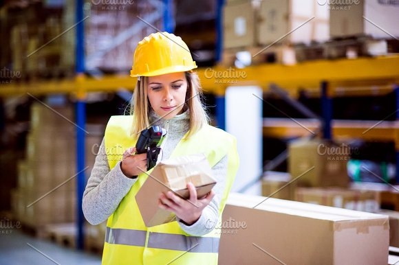 Warehouse Woman Worker With Barcode Scanner