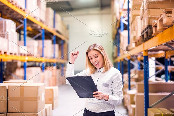 Overjoyed Female Worker Or Supervisor In A Warehouse
