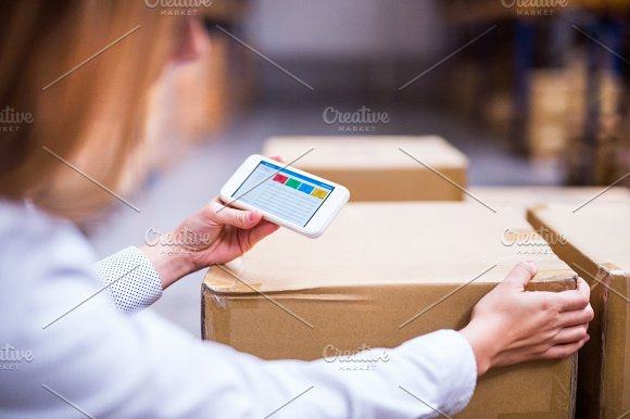 Woman Warehouse Worker Or Supervisor With Smartphone