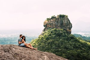 Couple in love on a rock