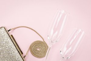 Festive golden clutch and two flutes