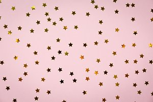 Golden star sprinkles on pink