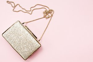 Festive golden clutch on pink