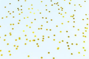 Golden star sprinkles on blue