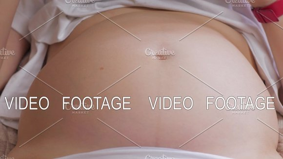 Pregnant Womans Belly With Baby Moving And Kicking Inside