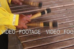 Asian Indonesian Balinese musician gamelan instrument. Closeup hands playing. Not edited, raw file.