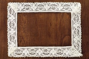 Crochet Frame on a Wooden Background