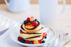 Breakfast, pancakes with cup of tea